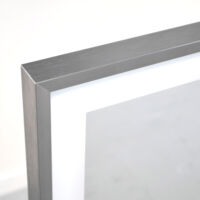 Infrared mirror plate with isolation backing for efficient warmth