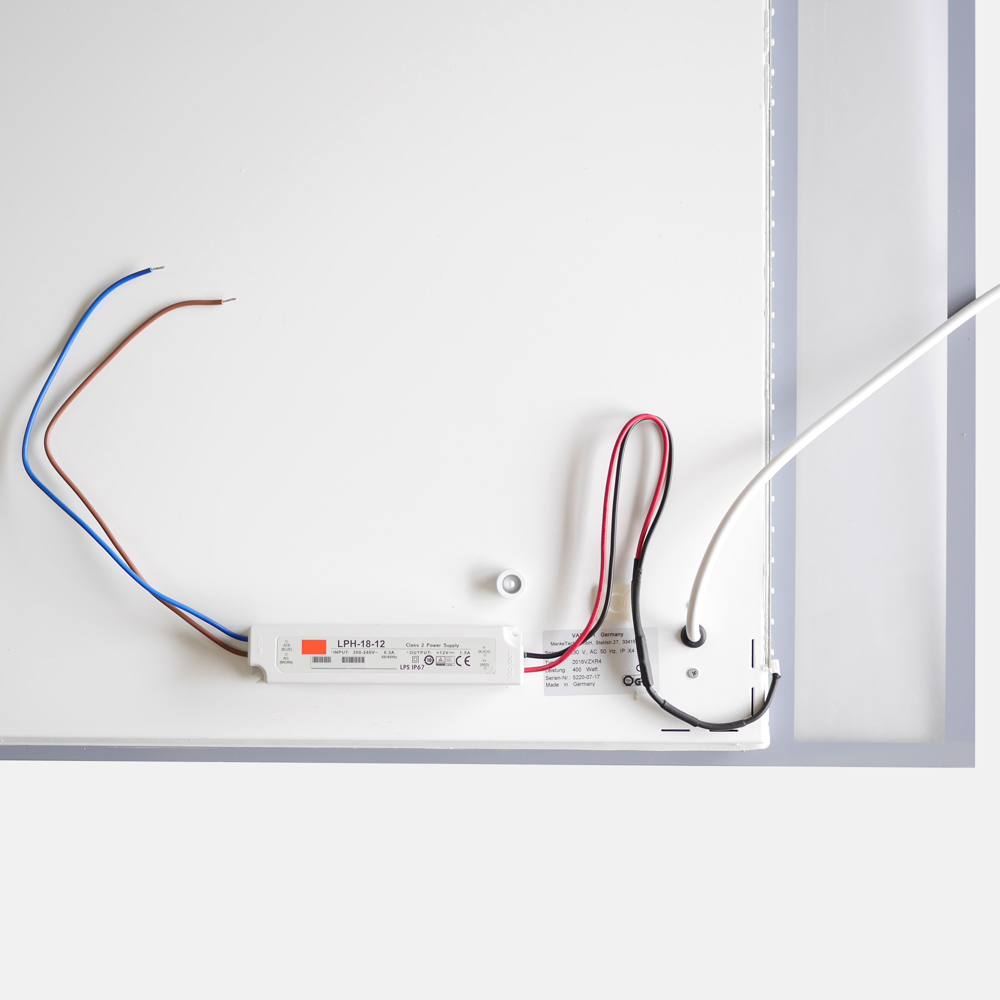 Mirror heating panel power connections for heat and light control